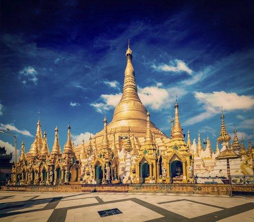 Vintage retro effect filtered hipster style image of Myanmer famous sacred place and tourist attraction landmark - Shwedagon Paya pagoda. Yangon, Myanmar