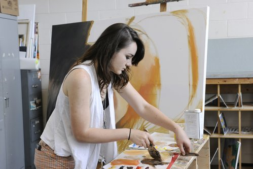 Art student painting on a canvas
