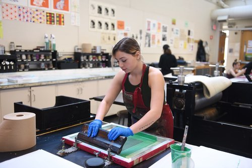 A student works carefully on an assignment for Printmaking class.