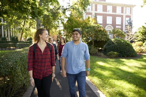 Students walk around the Adelphi campus on a sunny day.