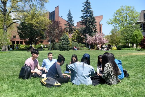 International students on the lawn.