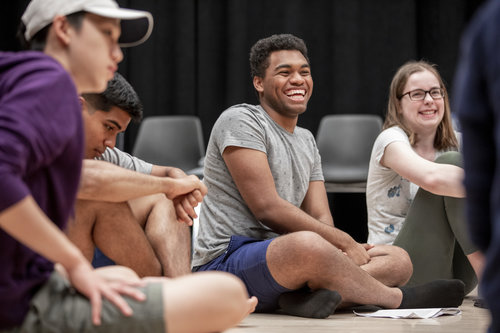Jessica Cerullo leads students in a beginning acting class in the Nancy Simon Acting Classroom in Harper Joy Theatre in April 2019. The class began with a warm up exercise, then discussion over techniques and a cold-read. Rony Peguero '22 (grey shirt, blue shorts) Matthew Dahlstrom '21 (hands crossed, on Rony's right side)