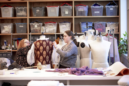 """Costume Director and Visiting Associate Professor Annaliese Baker and Grace Sanwald '21 (Classical Studies) work on costumes for """"Life is a Dream"""" in the Costume Shop in Harper Joy Theatre in April 2019."""