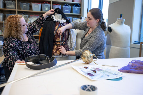 "Costume Director and Visiting Associate Professor Annaliese Baker and Grace Sanwald '21 (Classical Studies) work on costumes for ""Life is a Dream"" in the Costume Shop in Harper Joy Theatre in April 2019."