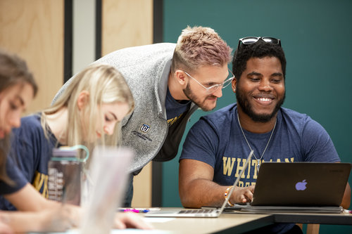 Members of Whitman College's Debate team participate in a practice in Maxey Hall in April 2019. Assistant director Baker Weilert works with students. Jordon Crawford