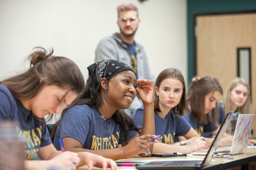 Members of Whitman College's Debate team participate in a practice in Maxey Hall in April 2019. Assistant director Baker Weilert works with students.