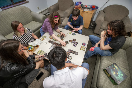 Members of Whitman's Tabletop Games Club play games in Douglas Hall in April 2019. Students are Ethan Raffman '20 (white shirt); Colleen Boken '19  (long black hair, leather jacket); Charlotte Nicholson '22 (striped shirt); Clara Redmond '22 (pink headband); Liam Dubay '21 (blue shirt); Mitchell O'Connor '21 (patched jeans)