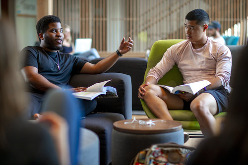 Jordon Crawford '21, left (black male); and Cody Jose '21, right (Latino male) study, play piano and hang out with friends in the front lobby of Stanton Hall in spring 2019.